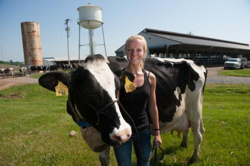 Melissa Shaughness, an animal science major, poses at UMD's dairy farm in Clarksville.